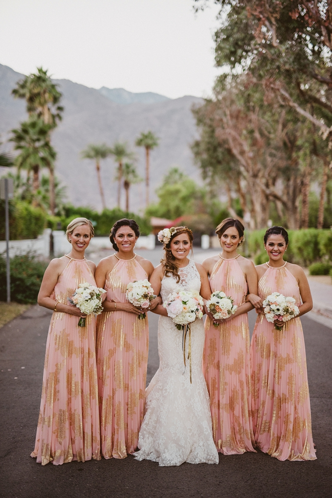 How fun are these blush and gold bridesmaid's dresses?! We love them!