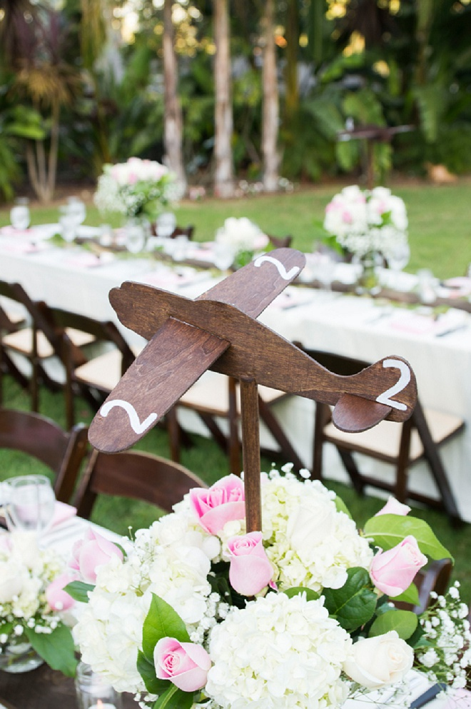 This pilot Groom and traveling couple crafted wooden airplanes for their table numbers and we love it!