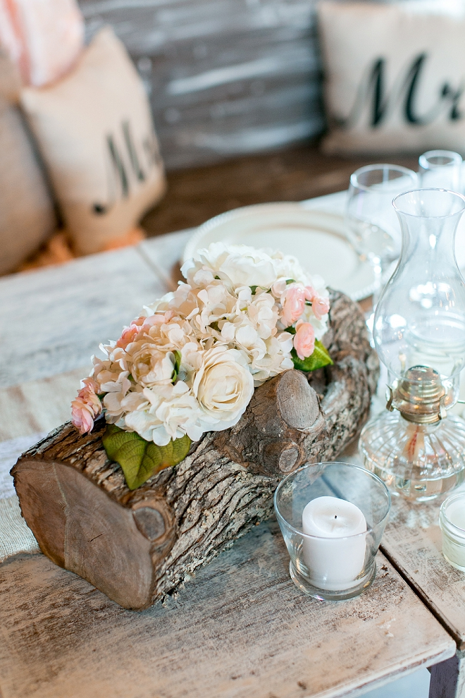 We love these floral and wooden centerpices!