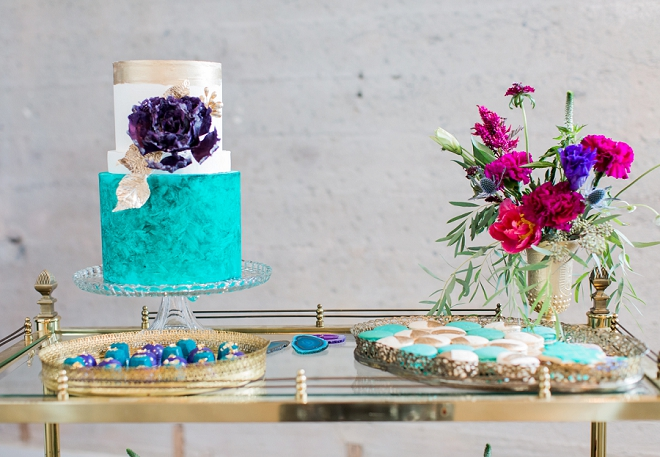 The gorgeous bold and bright desserts at this styled weddings dessert bar!