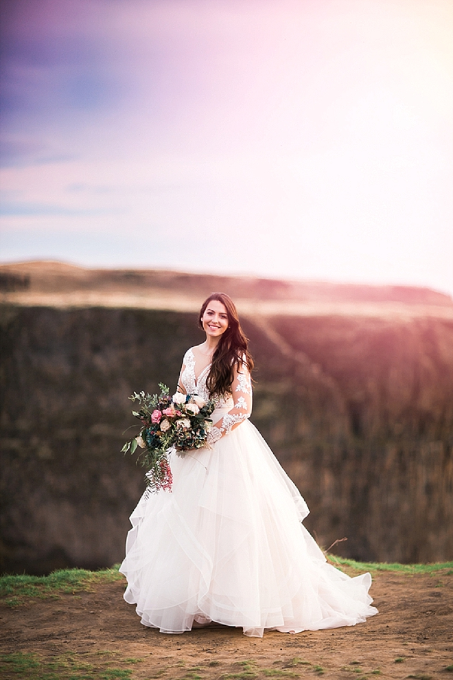 We are in LOVE with this Bride's long sleeved wedding dress and bouquet at her styled anniversary shoot!