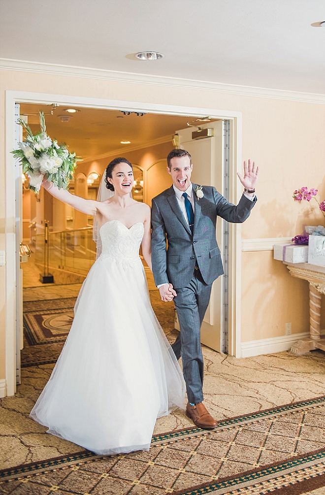 The new Mr. and Mrs. entering their reception!