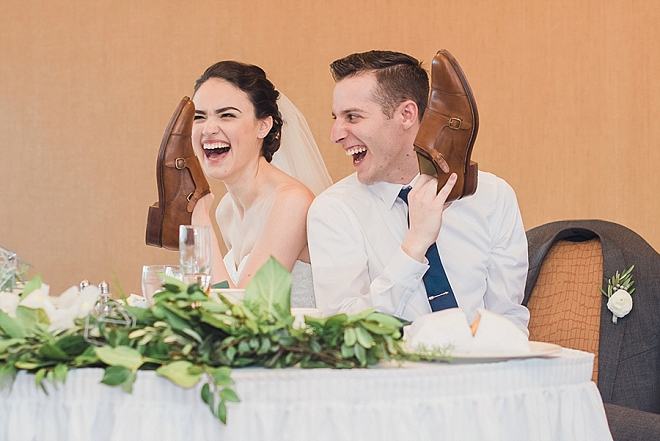 Such a fun snap of this new Mr. and Mrs at their reception!