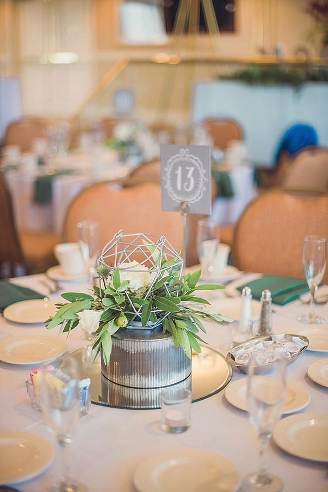 We love the clean and modern centerpieces and table numbers at this stunning affair!