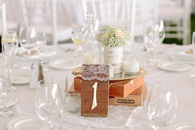 We love these gorgeous wooden and lace table numbers at this gorgeous reception!