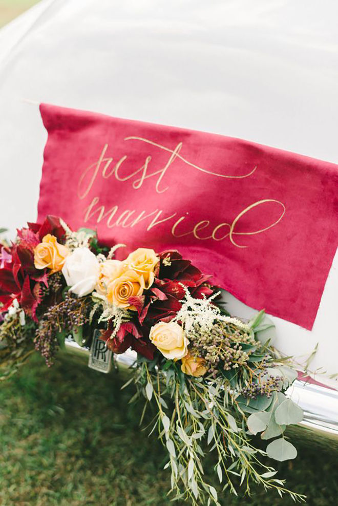 We love this punchy banner and swag decor for a wedding getaway car.