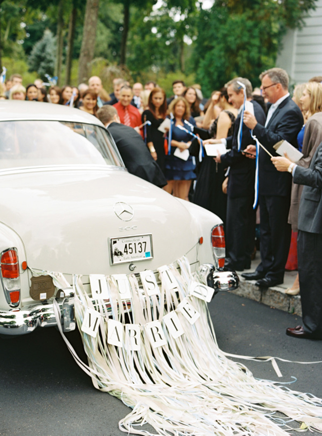 Ribbon and banner look fun and fancy on a getaway car.