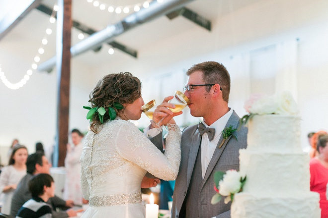 We're LOVING this shot of the Bride and Groom and their gorgeous gold toasting glasses!