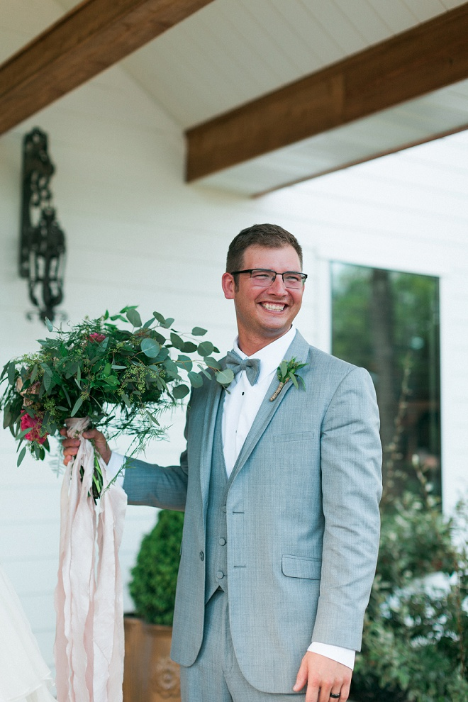 How darling is this shot of the Groom with his Bride's bouquet?! Love!