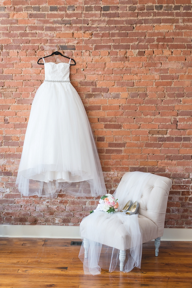 How gorgeous is this Bride's classic wedding gown?! We're in love with the story of this dress!
